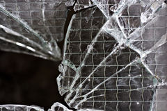 Closeup of a shattered glass window. Closeup shot of a shattered glass window stock photo