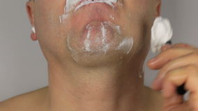 Closeup  shave a man, shaving razor with a blade stock video