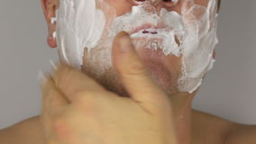 Closeup  shave a man, use shaving foam on face stock video footage