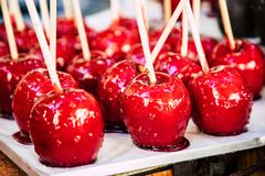 Closeup of shinny red candy apples royalty free stock photography