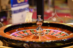 Closeup of shiny wooden roulette in casino, selective focus Stock Images