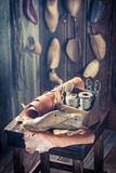 Closeup of shoemaker workshop with shoes, laces and tools. On wooden table stock photography
