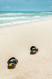 Closeup of shoes on the beach Royalty Free Stock Photos