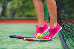 Closeup of shoes with the tennis racquet and ball Stock Photo