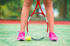 Closeup of shoes with the tennis racquet and ball Royalty Free Stock Photos