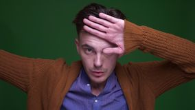 Closeup shoot of adult attractive man dabbing with confidence looking at camera with background isolated on green stock video footage