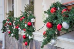 Closeup shoot of christmas decoration balls on facade of a cafe stock photos