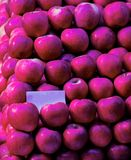 Closeup shoot of the red apples. In the raws at market Royalty Free Stock Photography