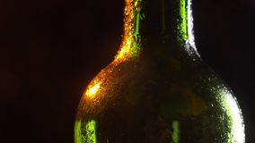 Closeup shoot of stunning shiny beer bottle spinning around in motion.  stock footage