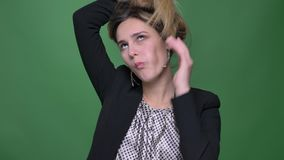 Closeup shoot of young attractive hipster caucasian female making different facial expressions and having fun looking