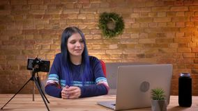 Closeup shoot of young cheerful female video blogger streaming live on the phone talking smiling happily using the stock footage