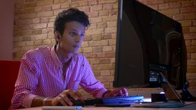 Closeup shoot of young indian attractive male gamer in vibes playing on the computer indoors in the cozy apartment with. Neon light stock video footage