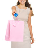 Closeup on shopping bags and credit card in hand Royalty Free Stock Photography