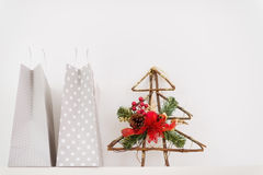 Closeup on shopping bags and decorative tree stock image