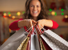 Closeup on shopping bags in hand of smiling woman Stock Photography