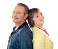 Closeup shot of aged couple, back to back Stock Image
