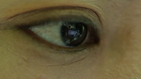 Closeup shot of asian female eye surfing internet stock video footage