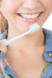 Closeup shot of asian woman brushing teeth Royalty Free Stock Photography