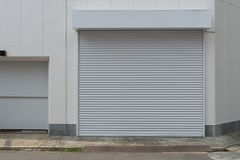 A closeup shot of automatic metal roller door used in factory. Storage, garage, and industrial warehouse. The corrugated and foldable metal sheet offer space royalty free stock images