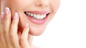 Closeup shot of beautiful female smile. White background Royalty Free Stock Photos