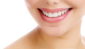 Closeup shot of beautiful female smile. White background Royalty Free Stock Image
