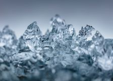 Closeup shot of beautiful frosty ice. With a grey background royalty free stock images
