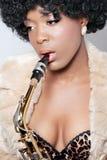 Closeup shot of a beautiful saxophone player Royalty Free Stock Image