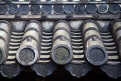 Closeup shot of the beautiful and traditional silver Japanese roof tiles