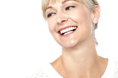 Closeup shot of a beautiful woman smiling heartily Stock Photography