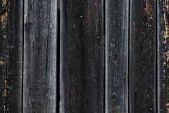 Closeup shot of black burnt on edges wooden planks Royalty Free Stock Photography