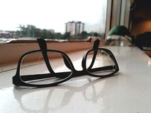 Closeup shot of black glasses. Closeup ahot of black glasses . No brand visible Stock Image