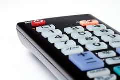 Closeup shot of a black tv remote control Stock Photography