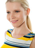 Closeup shot of blond girl looking away. Blond girl smiling and looking away isolated over white background Royalty Free Stock Photos
