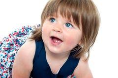 Closeup shot of blonde cute baby girl crawling Royalty Free Stock Photography
