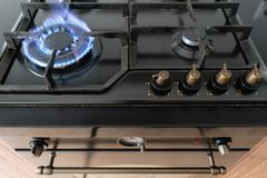 Closeup shot of blue fire from domestic kitchen hob. Gas cooker with burning flames propane gas. Closeup shot of blue fire from domestic kitchen hob. Gas cooker royalty free stock image