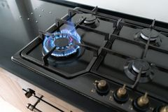 Closeup shot of blue fire from domestic kitchen hob. Gas cooker with burning flames propane gas. Closeup shot of blue fire from domestic kitchen hob. Gas cooker royalty free stock photos