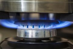 Closeup shot of blue fire from domestic kitchen stove. Gas cooke. R with burning flames propane gas stock photo