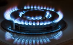 Closeup shot of blue fire from domestic kitchen stove. Gas cooke. R with burning flames propane gas royalty free stock photos
