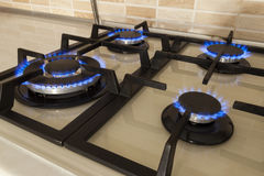 Closeup shot of blue fire from domestic kitchen stove. Gas cooke Stock Photography