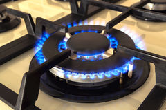 Closeup shot of blue fire from domestic kitchen stove. Gas cooke. R with burning flames propane gas royalty free stock image