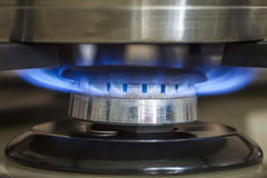 Closeup shot of blue fire from domestic kitchen stove. Gas cooke. R with burning flames propane gas stock photography