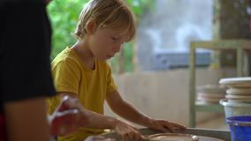 Closeup shot of a boy on a pottery master class.  stock video footage
