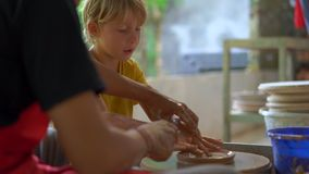 Closeup shot of a boy on a pottery master class.  stock footage