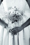 Closeup shot of bridal flower bouquet held by a Royalty Free Stock Photos