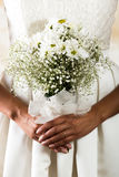 Closeup shot of bridal flower bouquet held by a Stock Image