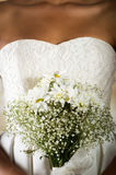Closeup shot of bridal flower bouquet held by a Stock Photos