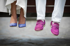 Closeup shot of bride and groom shoes: blue and purle closeup Royalty Free Stock Photo
