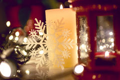Closeup shot of burning candle on decorated Christmas table Stock Images