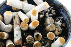 Closeup shot of burnt cigarette butts Royalty Free Stock Images