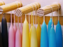 Candles colourful. On rack. royalty free stock photography